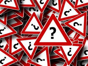 triangular question-mark signs with red borders