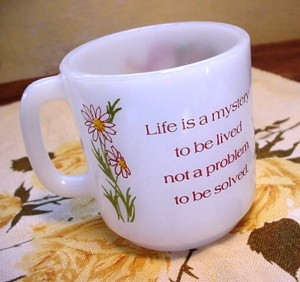mug with life is a mystery on it
